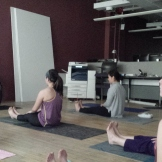 Pam teaching the BAM team yoga basics, starting with Dandasana (Seated Mountain Pose) and reciting a poem to bring us to a calm place.